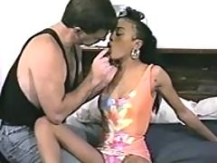 Little ebony doll trains her mouth