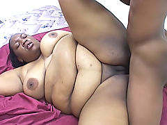 Big black bitch moans as her fat pussy gets slammed hard